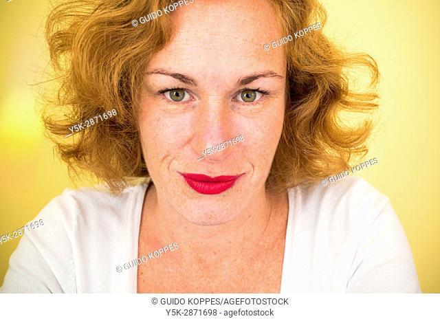 Tilburg, Netherlands. Studio Portrait of a red headed adult caucasian woman