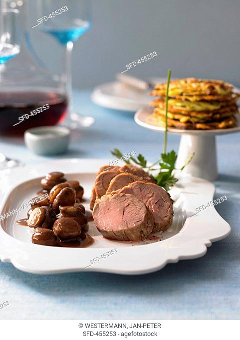 Pork medallions with courgette cakes