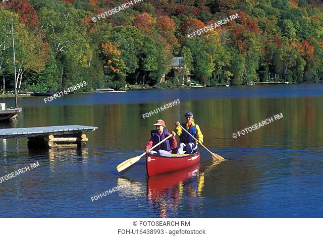 canoeing, canoe, Vermont, VT, Mother and daughter paddle a red canoe on Long Pond in Westmore in the fall surrounded by colorful foliage