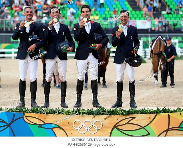 Gold medalist team Germany Karim Laghouag, Mathieu Lemoine, Astier Nicolas, Thibaut Vallette celebrate on the podium during the medal ceremony after the...