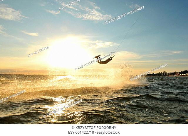 Portrait of a kiteboarder before sunset