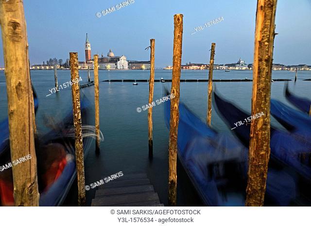 San Giorgio Maggiore church and gondolas at dusk, Venice, Italy long exposure
