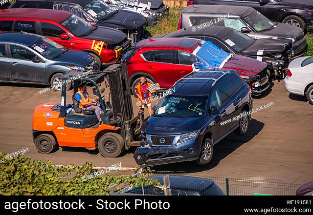 Odessa, Ukraine 09. 16. 2019. Broken cars for export in the cargo port and container terminal in Odessa, Ukraine, on a sunny day