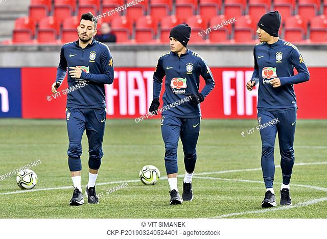 Brazilian football players L-R ALEX TELLES, PHILIPPE COUTINHO, ROBERTO FIRMINO in action during the training session prior to friendly match Czech Republic vs