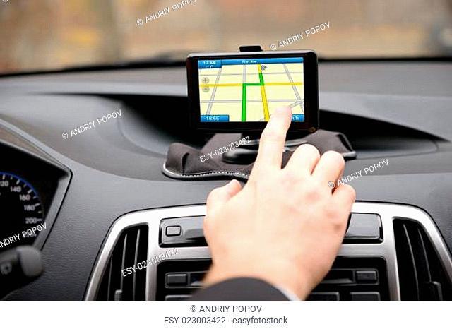 Man Using Gps Navigation While Driving