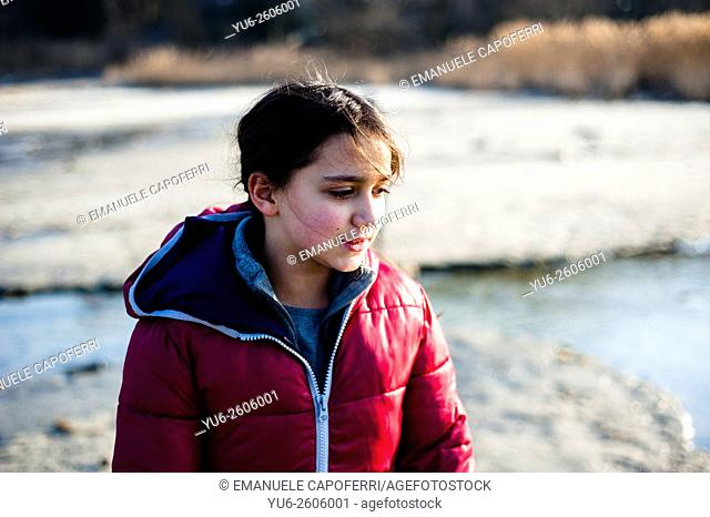Little girl on the lake Maggiore Winter Beach, Ispra, Lombardy, Italy