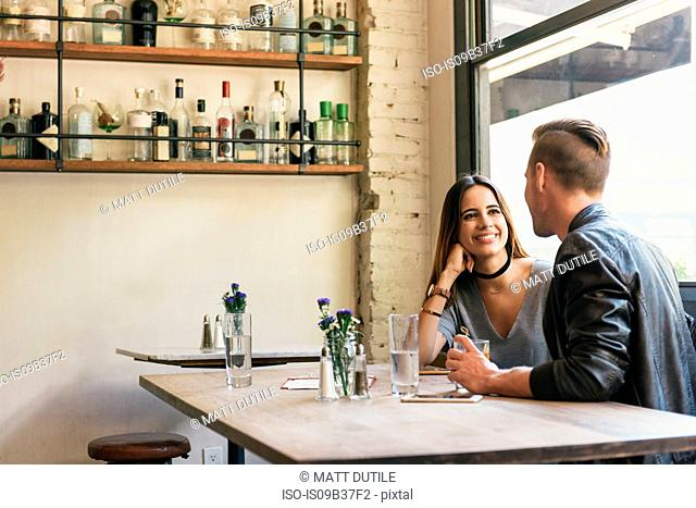 Young couple chatting in restaurant