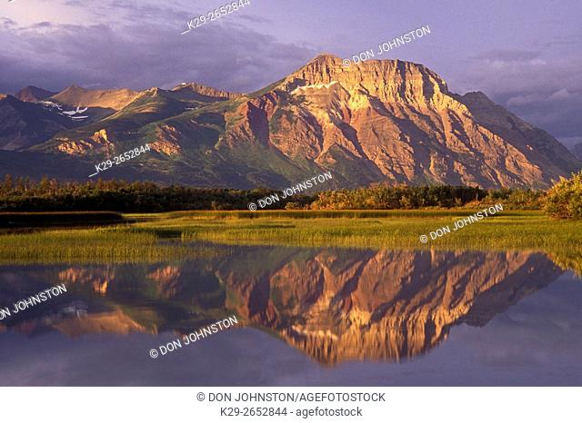 Vimy Ridge at dawn reflected in Maskinonge Ponds, Waterton Lakes National Park, AB, Canada