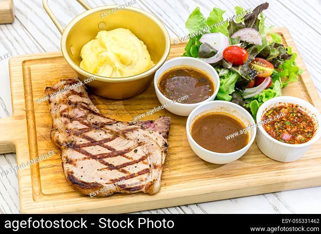 australian t-bone beef steak serve with fresh vegetable