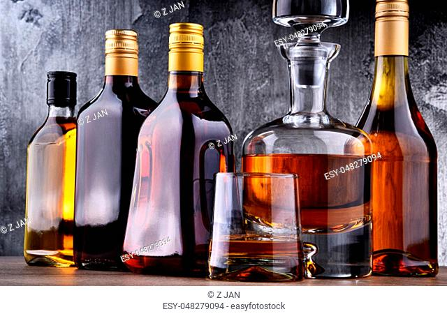 Composition with carafe and bottles of assorted alcoholic beverages