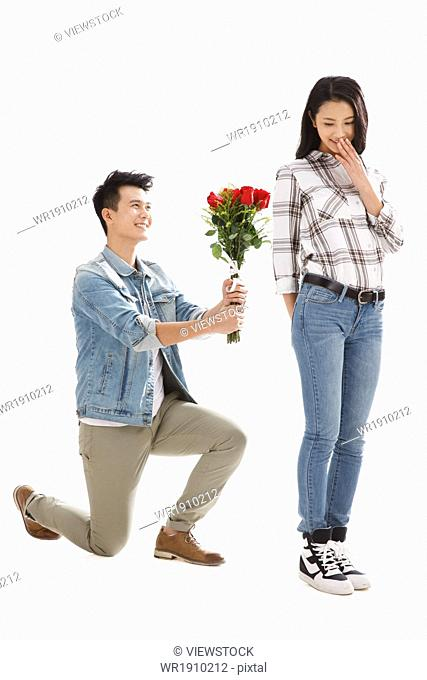 The young man gave the young woman flowers