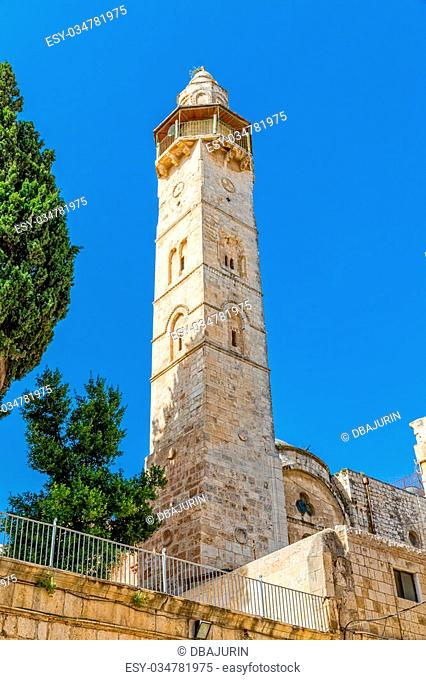 Omer mosque minaret in front of the Church of the Holy Sepulchre in Jerusalem, Israel