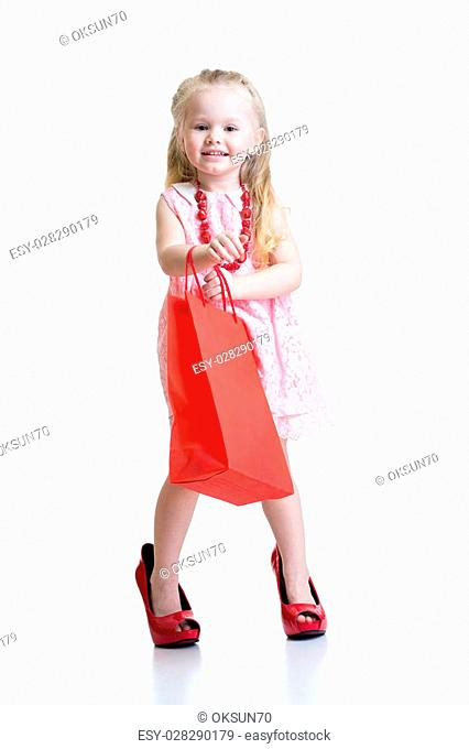 little girl in mother shoes isolated on a white background
