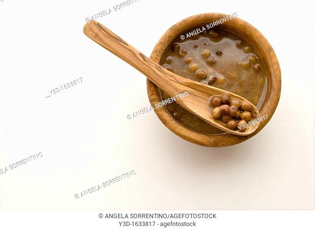 Roveja: an ancient kind of peas used as food  Raw and dried seeds isolated on white
