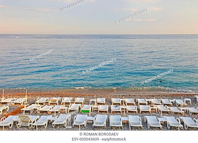 Lot of sun loungers on the beach of Nice, France