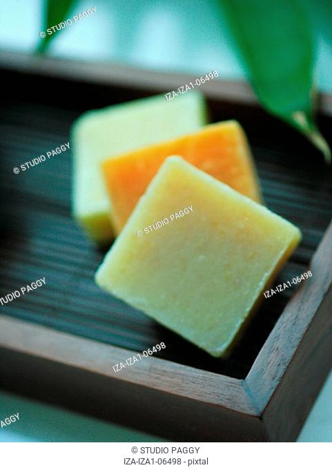 Close-up of natural soaps in a tray