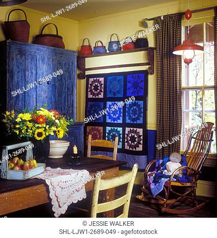 DINING ROOMS - Country charm, yellow walls, weathered stepback armoire, colorful baskets on display. Amish quilt in blue hues hangs on wall