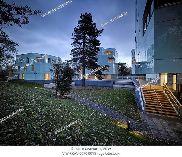 Dusk view of exterior showing light and landscape. Dunluce Apartments, Ballsbridge, Ireland. Architect: Derek Tynan Architects, 2016