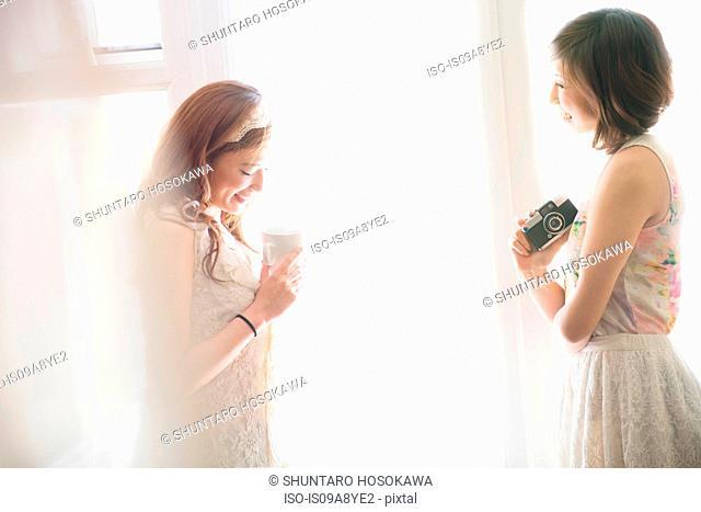 Two happy women chatting