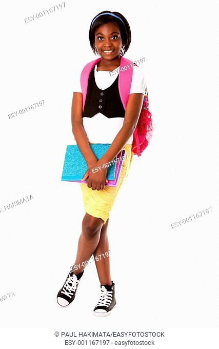 Beautiful happy student girl with colorful notebooks and backpack ready for school, isolated