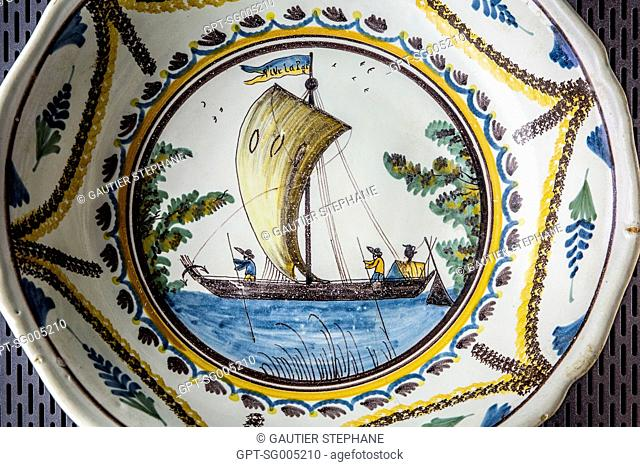 18TH CENTURY NEVERS PORCELAIN REPRESENTING A BARGE OF THE LOIRE WITH TWO SAILORS HANDLING THE GUNWALE TO OFFSET THE WIND, MARINE MUSEUM, CHATEAUNEUF SUR LOIRE