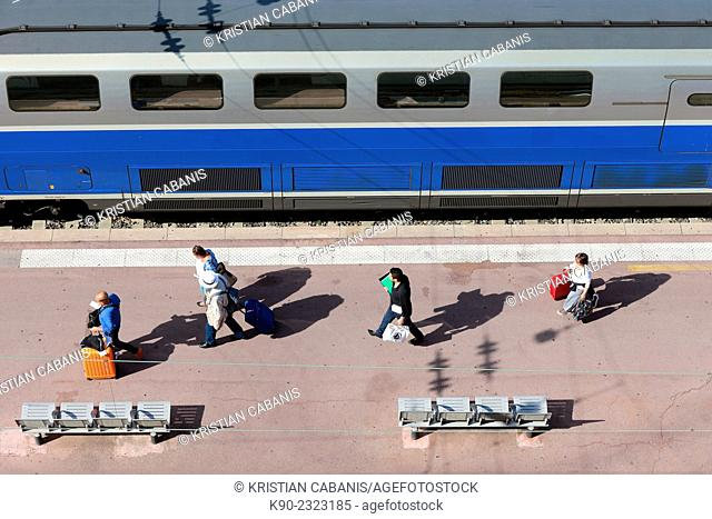 People with baggage walking along the platform of Nice mainstation, South France, Europe
