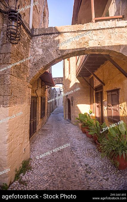 Narrow street in the medieval city inside of Fortifications of Rhodes. Greece