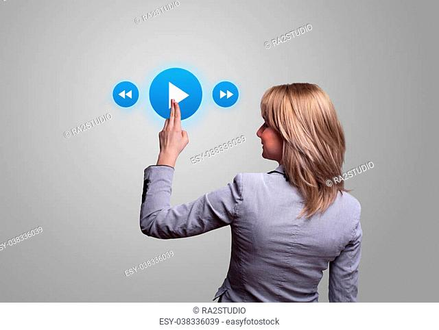 woman hand pressing media player button