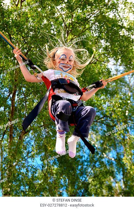 child clown jumping