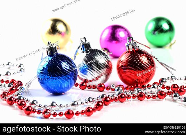 Christmas balls with ornaments on white background
