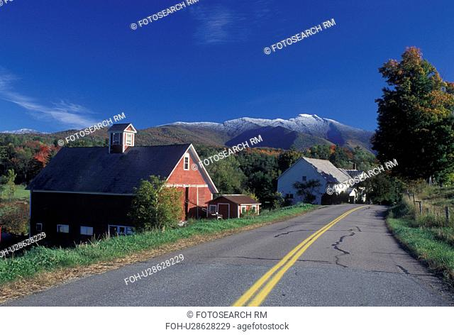 mountain, snow, farm, Cambridge, VT, Vermont, Mt. Mansfield, Scenic view of the first snow on Mount Mansfield in the fall from a country road winding along next...