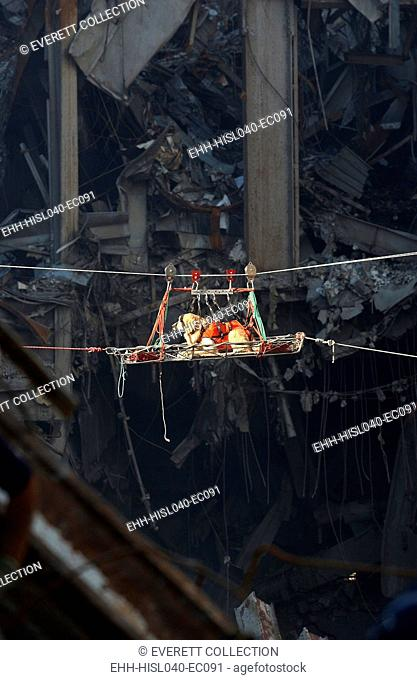 A rescue dog is transported out of the debris of the World Trade Center, Sept. 15, 2001. New York City, after September 11, 2001 terrorist attacks. U
