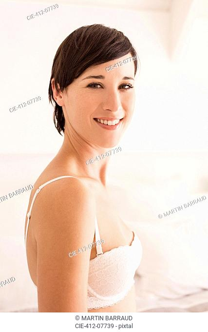 Portrait of smiling woman in bra
