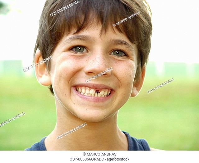 a boy smilling and looking happy