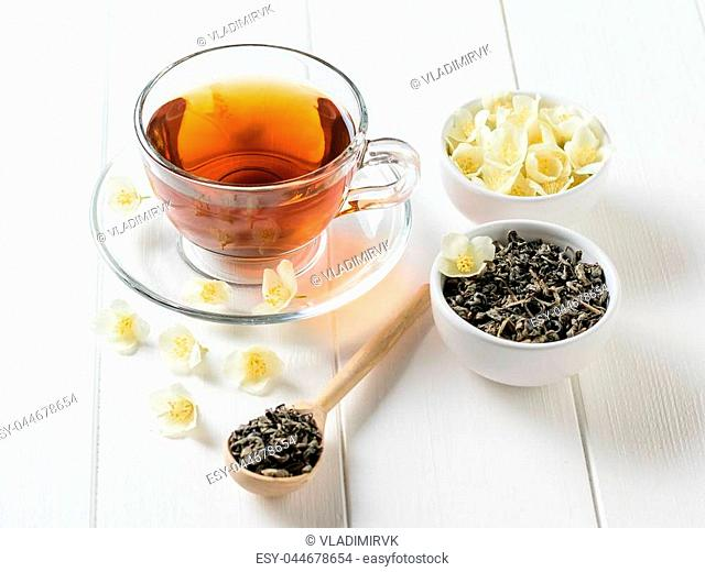 Freshly prepared tea with Jasmine flowers on a white wooden table. The view from the top. Spring tea composition