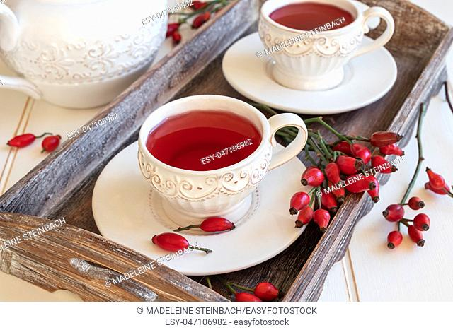 Rose hip tea in white vintage cups