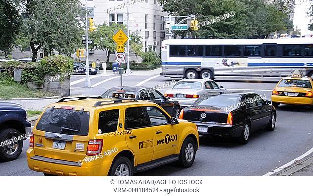 Vehicles traversing Central Park, New York City