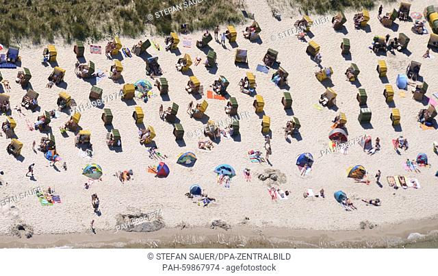Beach chairs lined up in rows at summerly weather, ready for the guests at the Baltic Sea beach of Binz (Mecklenburg-Western Pomerania), Germany, 01 July 2015