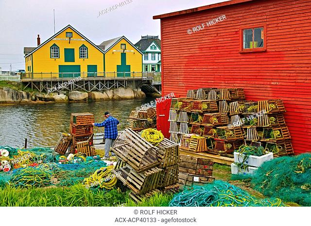 Fishermand with lobster traps, Barbour Living Villiage Heritage, Kittiwake Coast, Newtown, Newfoundland, Canada