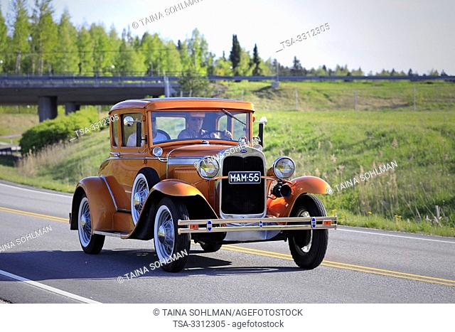 Salo, Finland. May 18, 2019. Beautiful orange Ford Model A classic car on the road on Salon Maisema Cruising 2019. Credit: Taina Sohlman/agefotostock
