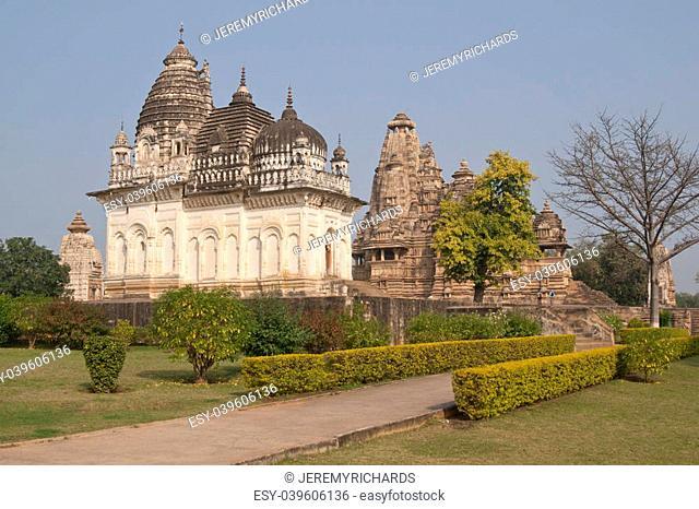 Ancient Hindu Temples in landscaped gardens at Khajuraho Uttar Pradesh India. 11th Century AD