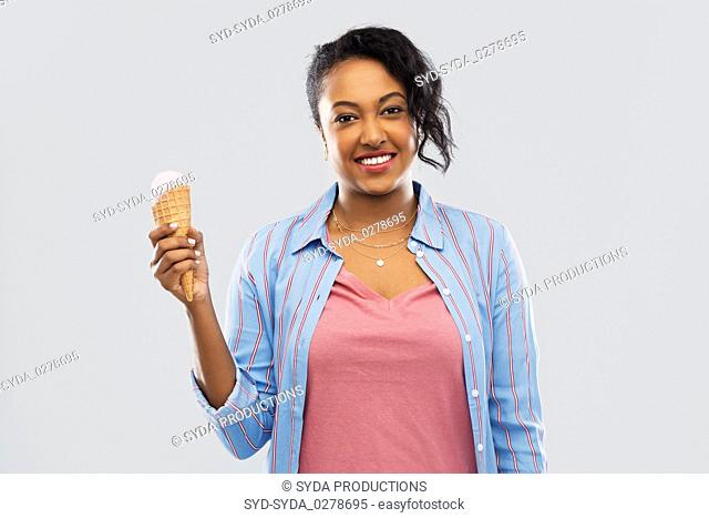 happy african american woman with ice cream cone