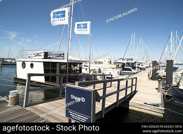 14 June 2020, Mecklenburg-Western Pomerania, Rostock: The sailing port of the Yachthafenresidenz Hohe Düne in Rostock-Warnemünde