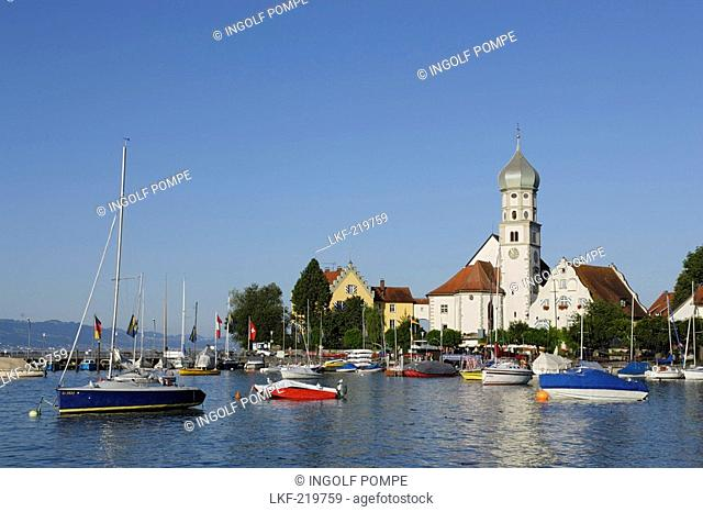 View over lake Constance to Wasserburg with St George's Church, Bavaria, Germany