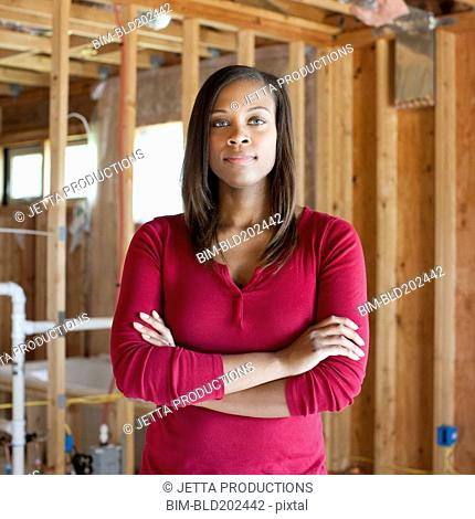 Black woman standing in unfinished room