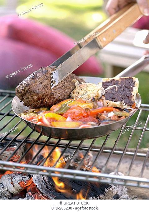Barbecued beef fillet with vegetables, olive paste on bread