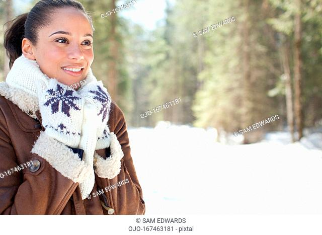 Smiling woman in snowy woods