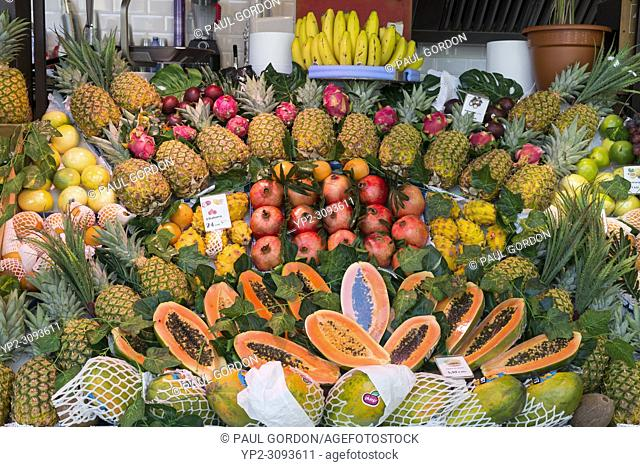 Madrid, Spain: Fresh tropical produce for sale at Mercado de San Miguel. Originally built in 1916, the landmark building was renovated and reopened it in 2009...