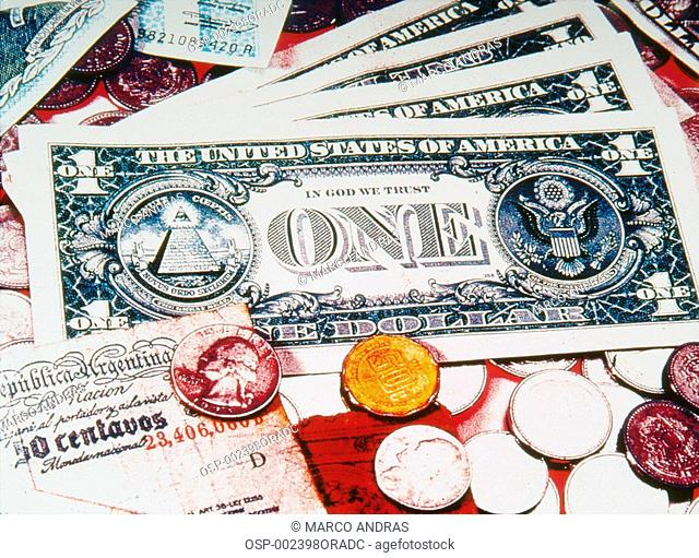 dollar bills and coins financial currency
