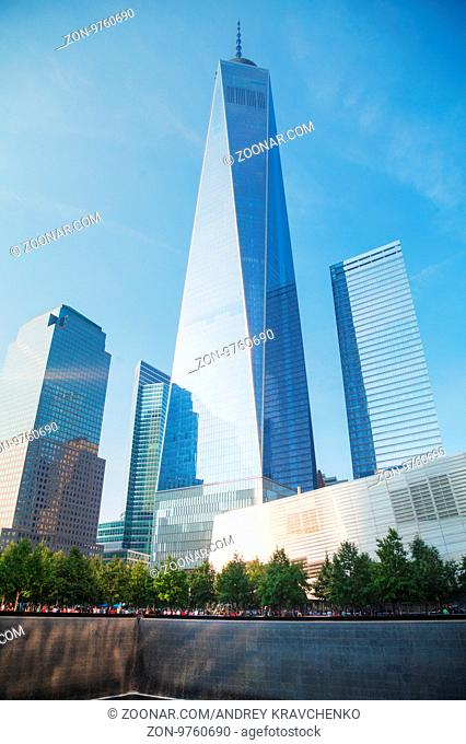 NEW YORK CITY - SEPTEMBER 3: One World Trade Center and 9/11 Memorial with people on September 3, 2015 in New York City